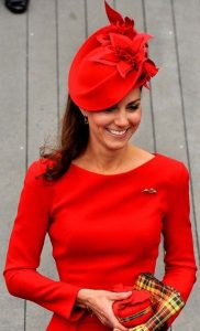 classy red fascinator hat with a matching purse