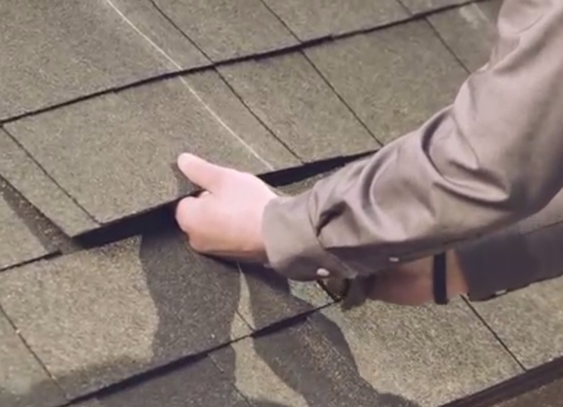 Using a flat bar to check for nails that will obstruct the flashings